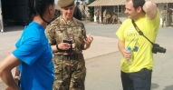 Skanska's Israil Bryan and chris Good chat to 225 Med Regt oc Helen Smyth