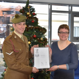 LCpl Trevor Stewart-East and Head Teacher Laura Smith with the Silver Award.