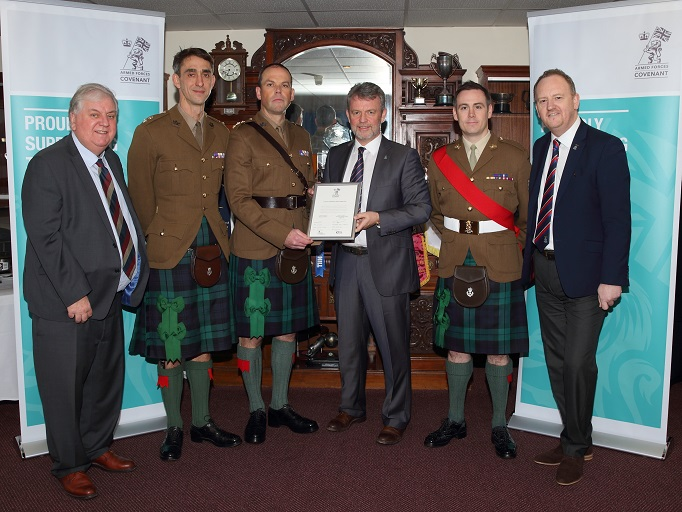 Inverness Caledonian Thistle staff posing with Armed Forces Covenant certificate