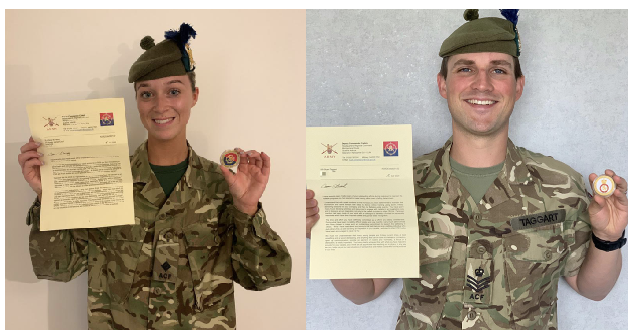 Adult volunteers holding Commanders Coins and letters