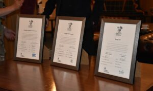 Award certificates in frames on table