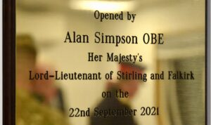 Decorative plaque to mark cadet centre opening.