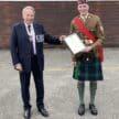Sam and Douglas with Lord Lieutenant award.
